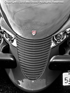 Selectively-colored black and white of Prowler automobile front end from We Shoot